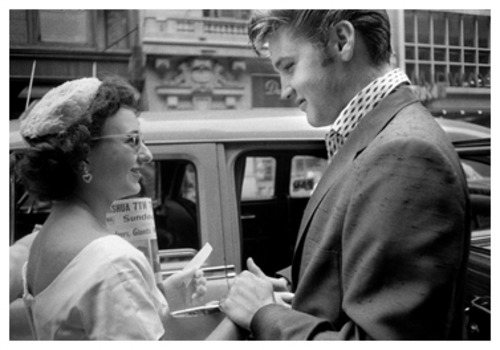 Elvis_greets_fan_in_white