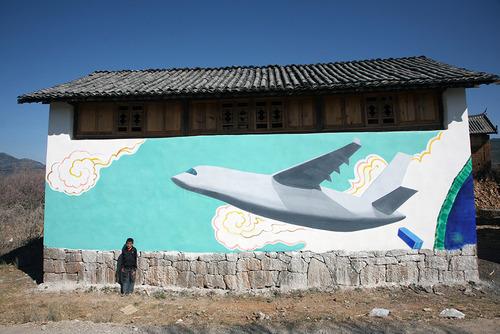 20120724140739-liu_bin____cargo_plane_above_lashihai__mural_at_he_simei_s_house
