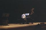 20150825125655-bakary_playing_piano_at_his_graduation__2015