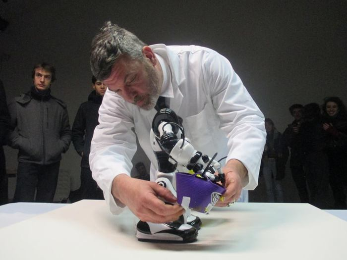Biomorphic Robot Action Painting Performance by Tom Estes