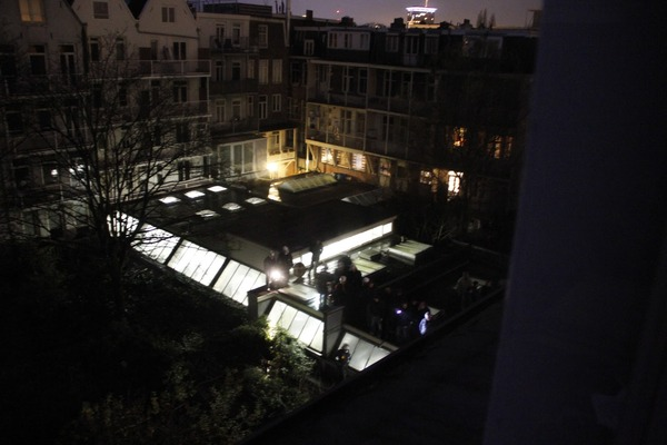 Cops in riot gear in the back courtyard.  Getting ready to evict the squatters next door.
