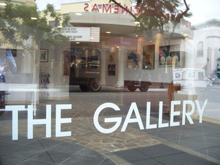 front window of gallery,