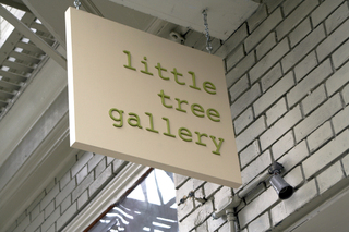 little tree gallery sign; hanging  tough,