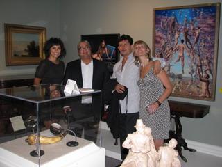 Miguel Tio, Nikki Schiro, jorge posada in front of miguel tio\'s artwork, Jorge Posada