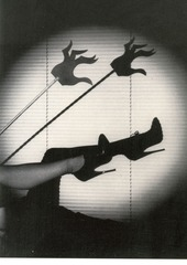 Untitled (Sandy Stagg models the Miss General Idea Shoe and the Hand of the Spirit against the backdrop of Luxon V.B.),