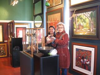 Maria V. Pinedo & Billie Quijano installing Mata Ortíz ceramics for Latin American Art & Ceramics in the Mission,