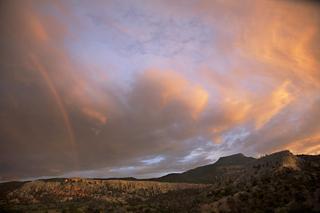 Late evening light w/ rainbow over Pedernal Mt., Walter W. Nelson