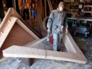 Esteban Bojorquez creating his art shack for the exhibition, Esteban Bojorquez