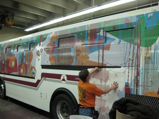 View of Art on Transit bus being wrapped, Ray CRO Noland