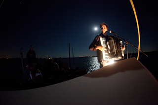 Jason Webley performing on the boat, Anja Ulfeldt, Chicken John Rinaldi, Paul Cesewski, Ben Burke, James Cross, Anton Berteaux, Richard Mortimer Humphrey
