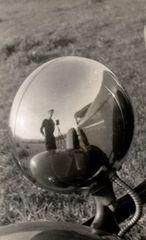 Self-Portrait in Headlight of 1932 DeSoto Coupe , Julius Shulman
