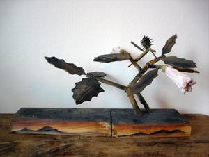 20100911085121-plant-_wood_sculpture