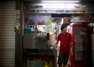 "Film still from ""Civic Life: Tiong Bahru"",Christine Molloy and Joe Lawler"