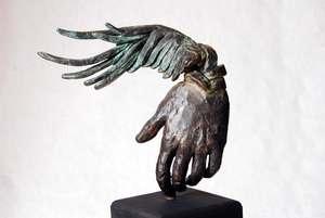 20101103223719-winged_hand_front