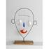20110318014816-upcoming3104_calder_little_face--wht-border-