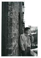 Heroic Portrait of Jack Kerouac with Railroad Brakeman\'s manual in pocket, Fire Escape, New York , Allen Ginsberg