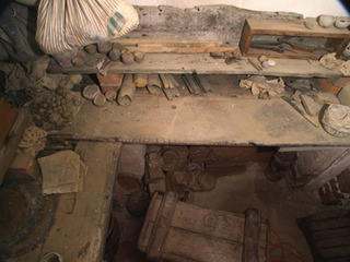 Installation detail of the inside of a hidden chamber, concealed behind a plaster coat in the basement of the historic Grange. A significant amount of beeswax was found, together with artefacts and simple tools.,Iris Hussler