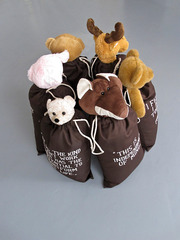 6 bagsculptures with softtoy and text in a circle,Mario Dalpra