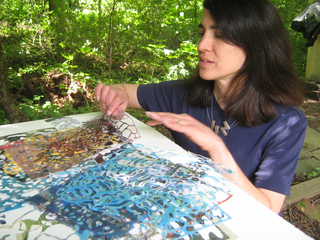 """Artist Eva Mantell with some of the reused and re-envisioned magazines that will be part of her video project, """"Float and Jumble."""", Eva Mantell"""