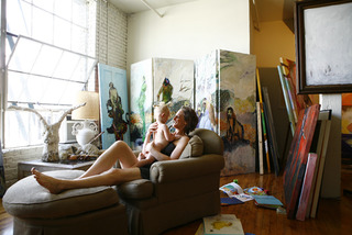 Photo of artist Courtney Reid in studio,