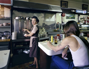 Pat Serving Coffee at the Budget Hotel, 7th and Mission Street, San Francisco, 1980 , Janet Delaney