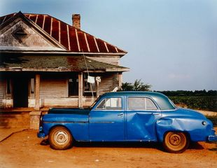 House and car near Akron, Alabama, William Christenberry