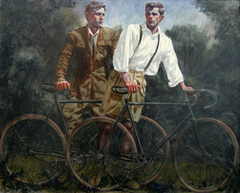 Two_men_standing_with_their_bicycles