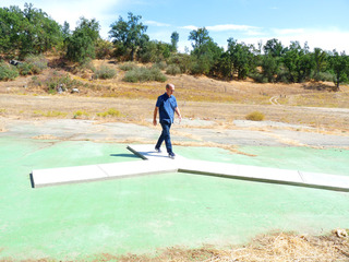 Tom McGlynn walking on his piece, &quot;Forked Path&quot;, 2011, concrete cast in-situ on the Hatchery site of &quot;East of Fresno&quot;,Tom McGlynn