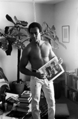 At Home, Huey P. Newton Listens to Bob Dylan\'s \'Highway 61 Revisited,\', Stephen Shames