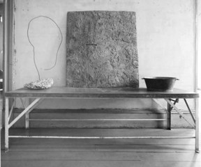 Table objects, left to right: Untitled (Africa/ear shape wire with cement base) ; Untitled (cement painting) ; Untitled (metal colander bowl with 7 dumbballs), David Ireland