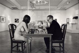 Marcel Duchamp playing chess with Eve Babitz  ,Julian Wasser