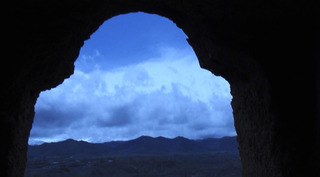 Jayce Salloum. Inside looking out, sky and hills (Buddhas cave site), from &quot;..the heart that has no love/pain/generosity is not a heart..&quot;, Bamiyan, Hazarajat, Afghanistan,Jayce Salloum