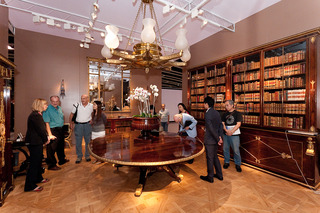 Carlton Hobbs, New York, reconstructed an entire elegant English drawing room at his booth, complete with a giant 22-foot rosewood table used for a 19th century royal peace treaty, a 400 lb chandelier, a wall-sized bookcase full of books and a hardwood pa,