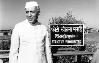 Jawaharlal Nehru caught by the camera at Palam airport while waiting for his sister, Vijayalakshmi Pandit, the Indian Ambassador in Moscow ,Homai Vyarawalla