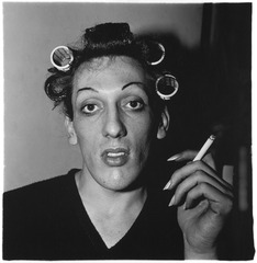 A young man in curlers at home on West 20th Street, N.Y.C, Diane Arbus