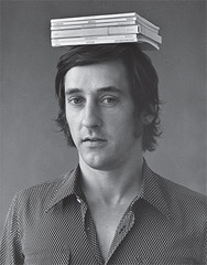 Ed Ruscha with six of his books on his head,Jerry McMillan
