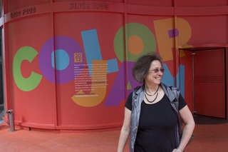 Internationally renowned multimedia artist Jessica Stockholder stands at the corner of State and Adams Streets in Chicago, where her Chicago Loop Alliance-commissioned vinyl artwork, Color Jam, envelopes the intersection with flashes of color and geometri, Jessica Stockholder