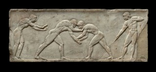 Base of a statue representing sports – two wrestlers,
