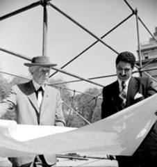 Frank Lloyd Wright and David Henken reviewing architectural drawings for the pavilion,