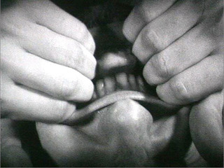 still from Pulling Mouth, Bruce Nauman