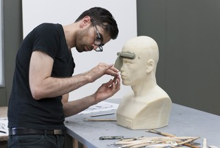 The Humans in progress; The artist at work in his studio.,Alexandre Singh