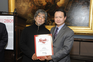 Receiving recognition from State Senator, Gong Yuebin