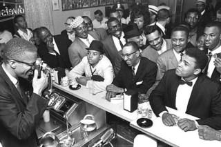 Black Muslim leader Malcolm X photographing Cassius Clay, Miami, Bob Gomel