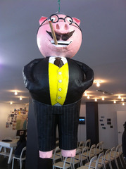 Capitalist Pig Piñata courtesy of Scott Hug,