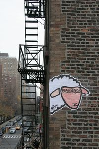20121218042019-a_sheep_around_a_fire_escape