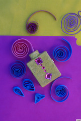 20121219231120-quilled_papers_bottle_jewels_aerial