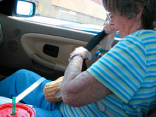 Wrestling with the seatbelt, Susan Myrland