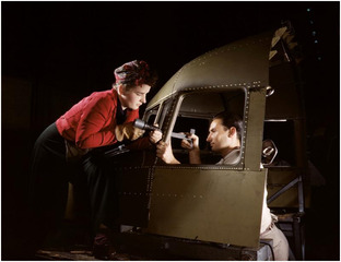 """Riveting team working on the cockpit shell of a B-25  [i.e. C-47] bomber at the plant of North American Aviation, Inc., Inglewood  [i.e. Douglas Aircraft Company, Long Beach], Calif."" ,Alfred T. Palmer"