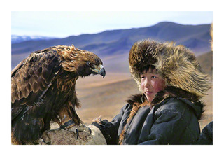 Deloun Highlands, Olgii Province, Outer Mongolia Khoda Bergen, a young Kazakh shepherd, is being trained to hunt with his uncle's hunting eagle.,