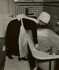 Parlourmaid Preparing a Bath before Dinner, Bill Brandt